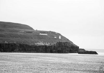 Carnet de voyage : Reportage photo en Iceland dans un ferry avec vue sur l'île. Photographe freelance en Gironde, Bordeaux.